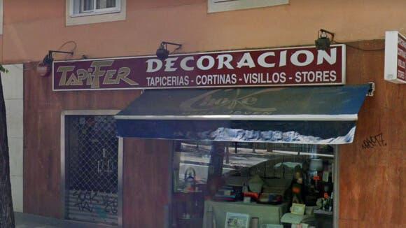 Hallan muerto a un hombre con signos de violencia en una tapicería de Madrid